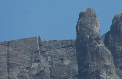 Person highlining at Lost Arrow Spire by Yosemite Falls, July 2009.